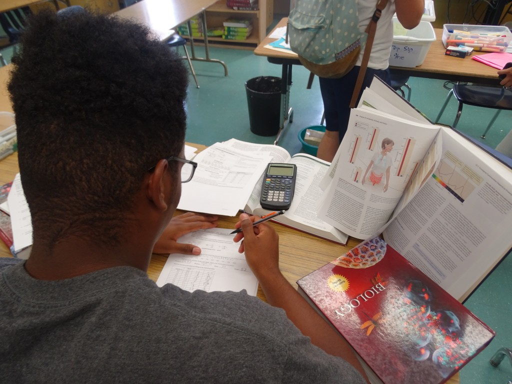 Junior Ezekiel Parks cramming at afterschool tutoring